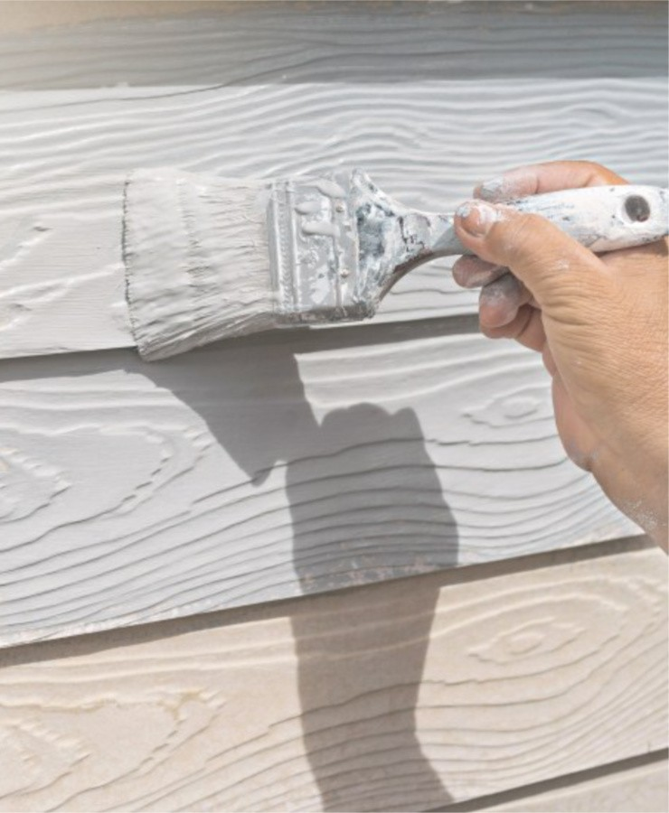 A contractor painting houses in Atlanta.