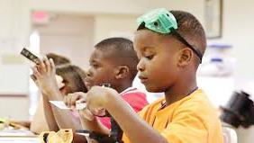 Summer scholars study science for free.  Youngsters at a GSC Pharmaceuticals program. Through fun activities, kids will learn how their circulatory and digestive systems power their bodies and their brains.