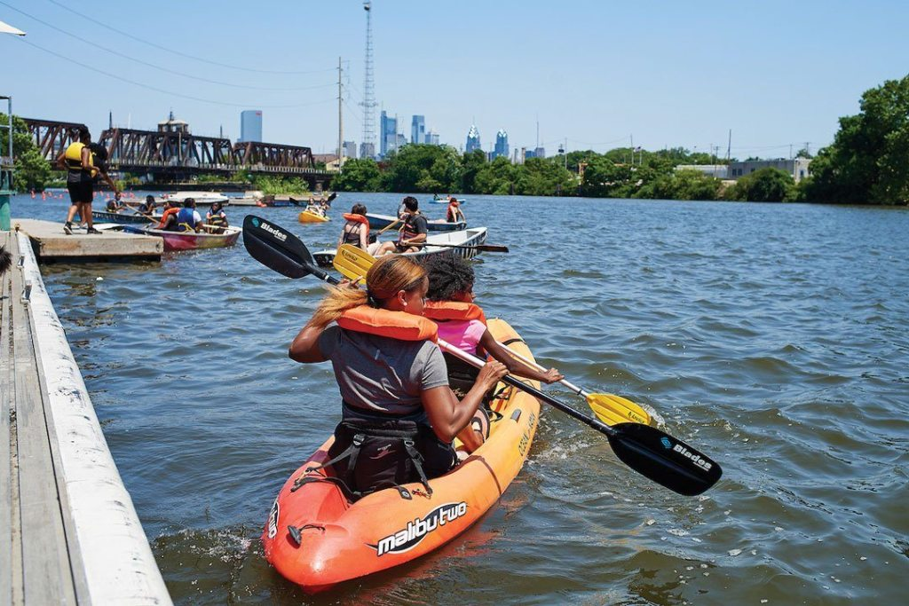 Boaters launch from the Bartram's Garden Community Dock on the cool Schuylkill River. Saturday boating is free.