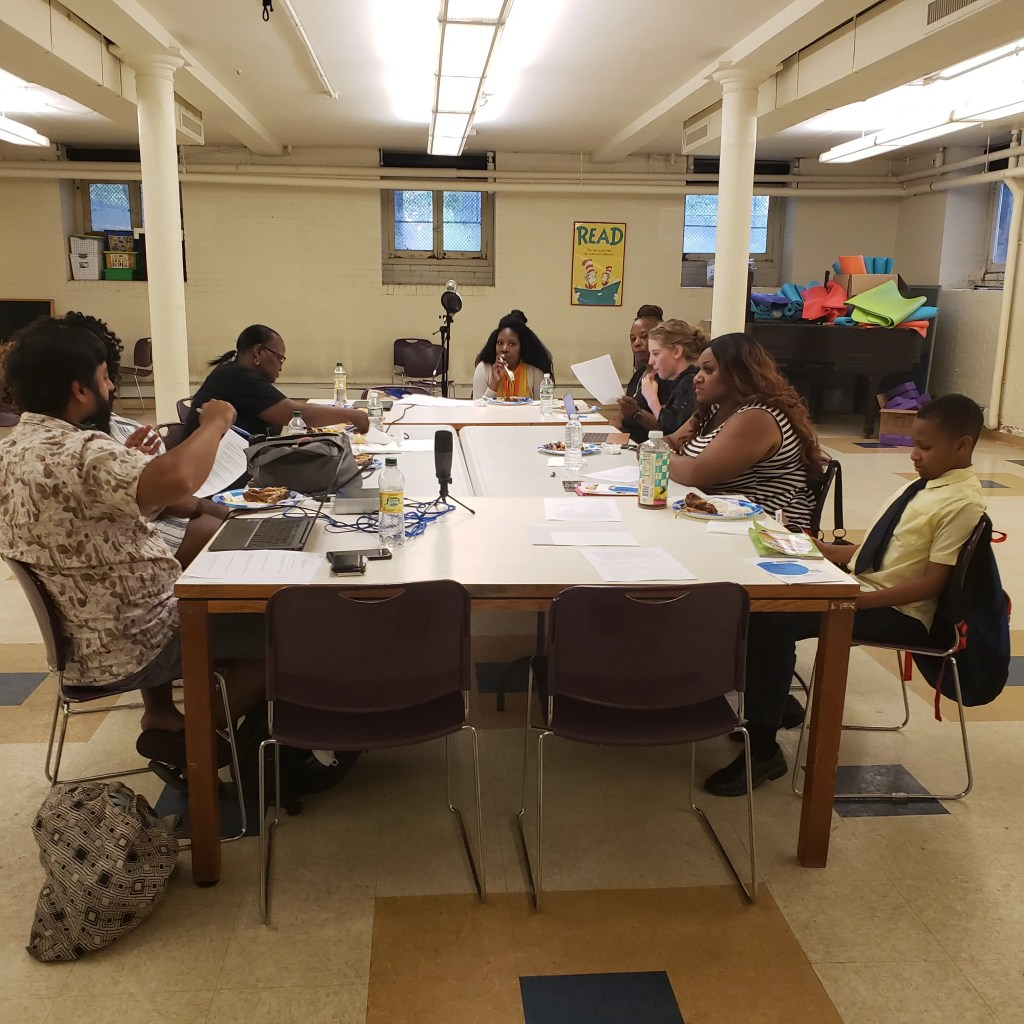 From left to right: Andrew Blassingame, Andrea Blassingame, Adrienne Harwell, Pat Erwin, Lapina Burris, Shirley Reynolds, Terica Green, and Neil Bardhan discuss ways to promote literacy in Southwest