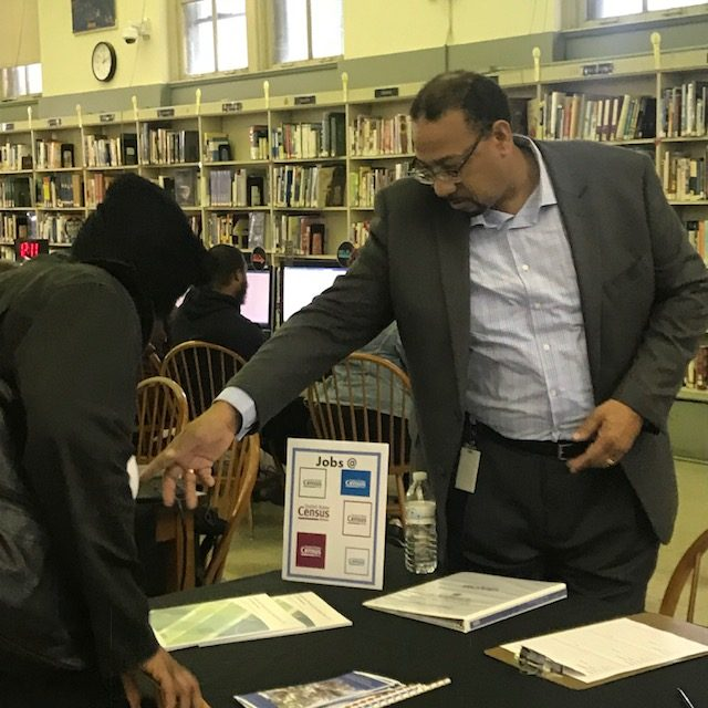 A job seeker and employer interact at Paschalville Library's Fall Job Fair in 2018.