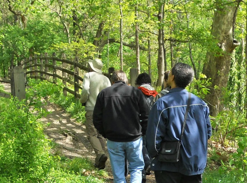 A group of bird watchers rambles down a Bartram's Garden nature trail along the Schuylkill River (photo taken before social distancing went into effect).  The quiet and beautiful trails are a superb place to spend a few pleasant hours absorbing nature's wonders.