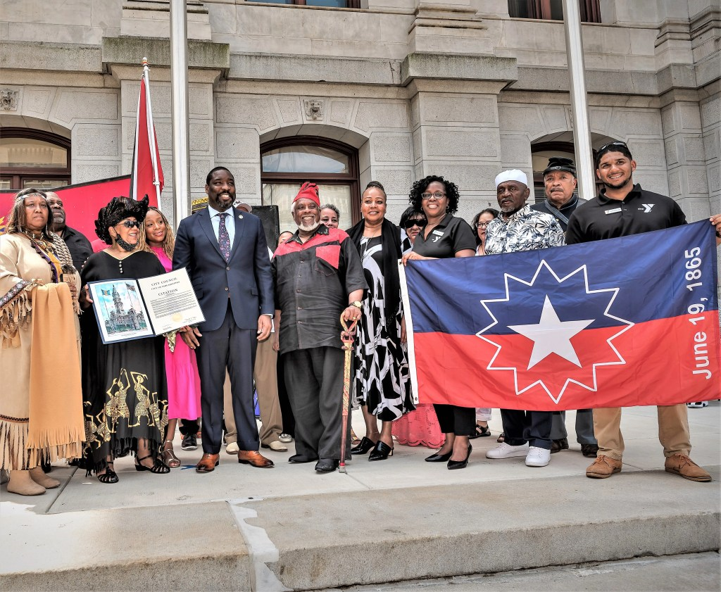 Councilman Kenyatta Johnson (center) with other civic leaders, members of the Philadelphia Juneteenth Family, and friends before the Juneteenth flag raising that began the celebration of Black emancipation in the city.