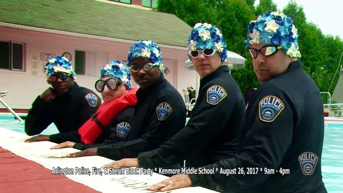 Police officers synchronize swim in uniform to promote block party