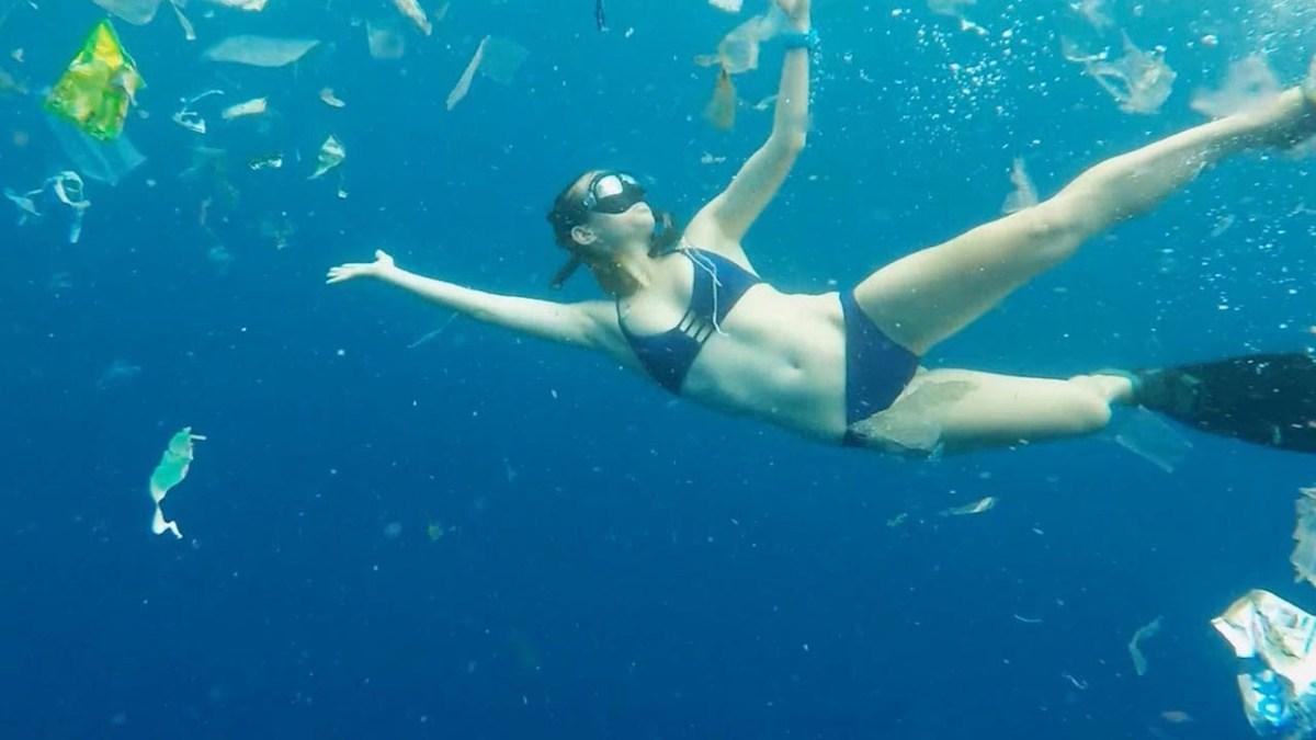 Perth free-diver Julia Wheeler swims through three tonnes of rubbish in Bali