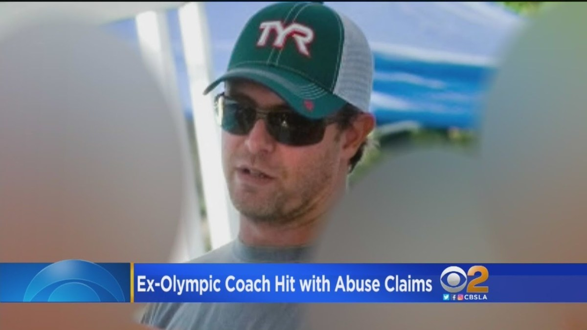 Swimming coach says he reported Sean Hutchison misconduct rumors years ago