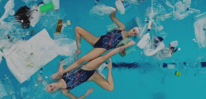 Mesmerising synchronised swimmers perform in plastic-littered pool