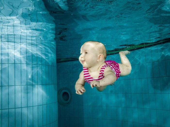 baby swimming photo
