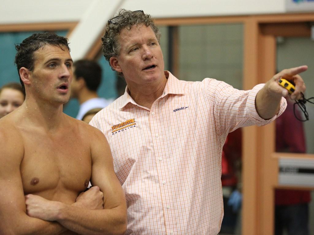 Jul 13, 2014; Athens, GA, USA; Swimming coach David Marsh talks with Ryan Lochte during the Sunday finals of the Bulldog Grand Slam at Gabrielsen Natatorium. Mandatory Credit: Kevin Liles-USA TODAY Sports