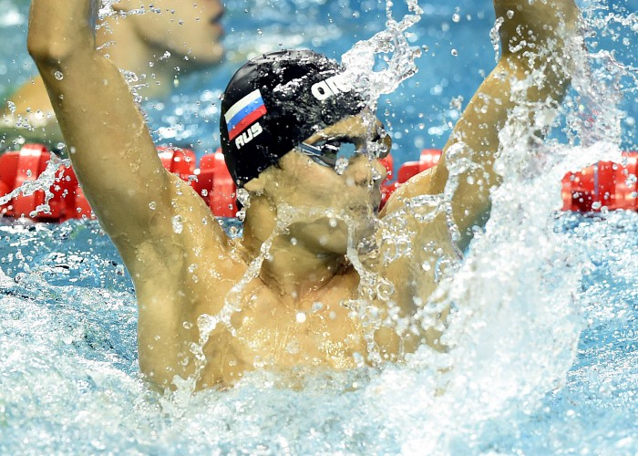 (140820) -- Nanjing, Aug 20,2014 (Xinhua) -- Evgeny Rylov of Russian Federation celebrates after the final of Men's 50m Backstroke of Nanjing 2014 Youth Olympic Games in Nanjing, capital of east China?s Jiangsu Province, on August 20, 2014. Evgeny Rylov won the gold. (Xinhua/Yue Yuewei) (lyq)