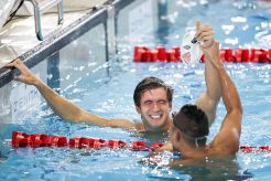 Swimming - Prudential Singapore Swim Stars 2014 - OCBC Aquatic Centre, Singapore Sports Hub, Singapore - 5/9/14 Men's 100m Freestyle - Nathan Adrian of USA (L) celebrates his win with Shinri Shioura of Japan Mandatory Credit: Action Images / Norman Ng Livepic EDITORIAL USE ONLY.