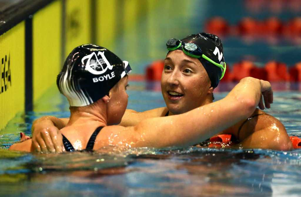 Emma Robinson is embraced by Lauren Boyle after both swimmers qualified for the World Champs in the 800m free during the New Zealand Open Swimming Championships, Westwave Aquatic Centre, Henderson, Auckland, Thursday 16 April 2015. Photo: Simon Watts/www.bwmedia.co.nz