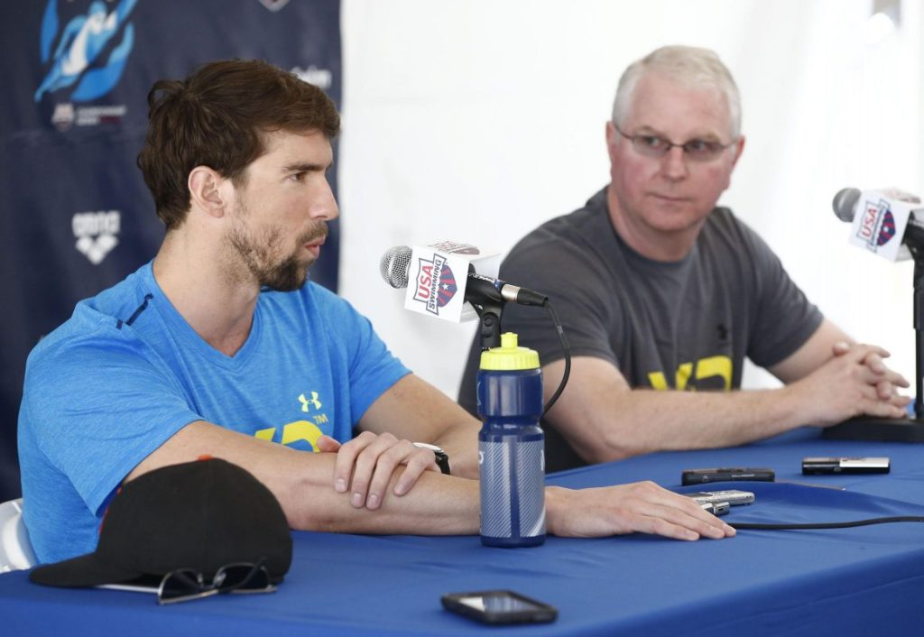 Apr 15, 2015; Mesa, AZ, USA; 18-time Olympic gold medalist Michael Phelps and coach Bob Bowman (right) hold a press conference at the Arena Pro Swim Series at Skyline Aquatic Center in Mesa, AZ. Phelps, 29, returns from a six-month suspension by USA Swimming after his arrest Sept. 30 when he was accused of driving under the influence. Phelps pleaded guilty to that charge in December was sentenced to 18 months supervised probation in lieu of one year in prison. The probation includes random drug and alcohol testing. Phelps also completed a 45-day treatment program in Arizona. Mandatory Credit: Rob Schumacher/Arizona Republic via USA TODAY Sports