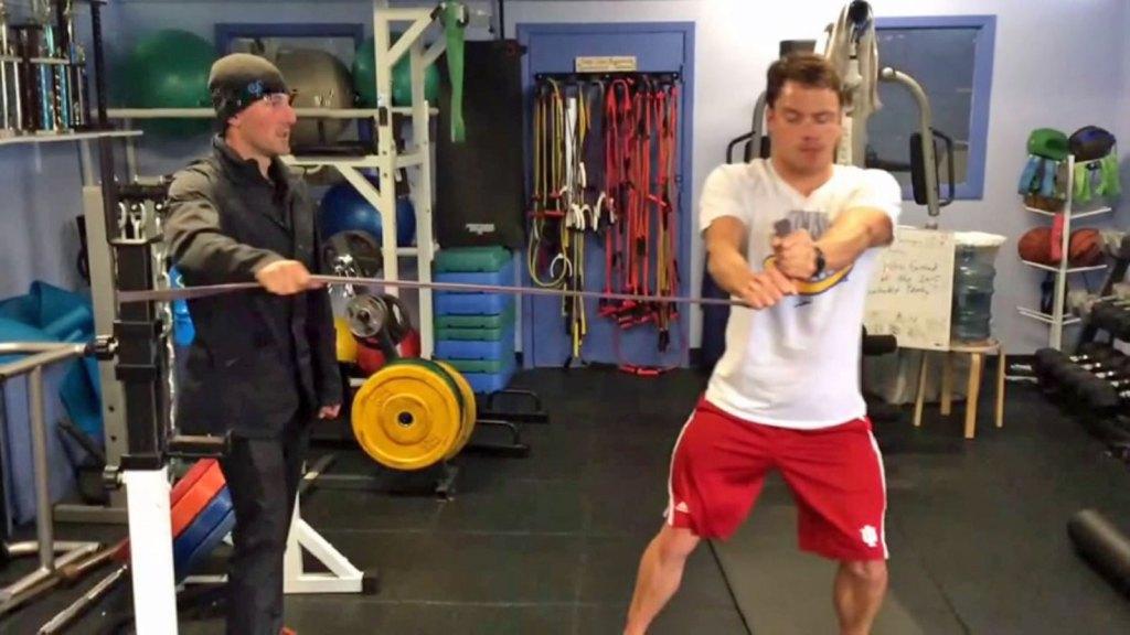 Anti-rotation walkout swimming core training exercise