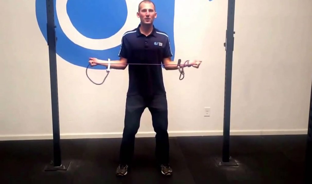 Band pull rotator cuff exercise for swimmers shoulder
