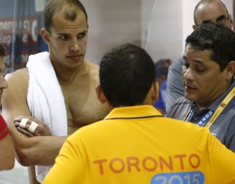 Jul 15, 2015; Toronto, Ontario, CAN; Michael Weiss of the the United States talks with officials after being disqualified form the men's 4x200m freestyle relay final for having his fingers taped during the 2015 Pan Am Games at Pan Am Aquatics UTS Centre and Field House. Mandatory Credit: Rob Schumacher-USA TODAY Sports