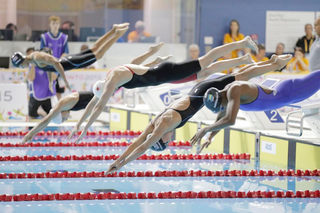 Jul 14, 2015; Toronto, Ontario, CAN; Natalie Coughlin of the United States dives into the pool with the rest of the field for the start of the women's 100m freestyle swimming final during the 2015 Pan Am Games at Pan Am Aquatics UTS Centre and Field House. Mandatory Credit: Erich Schlegel-USA TODAY Sports