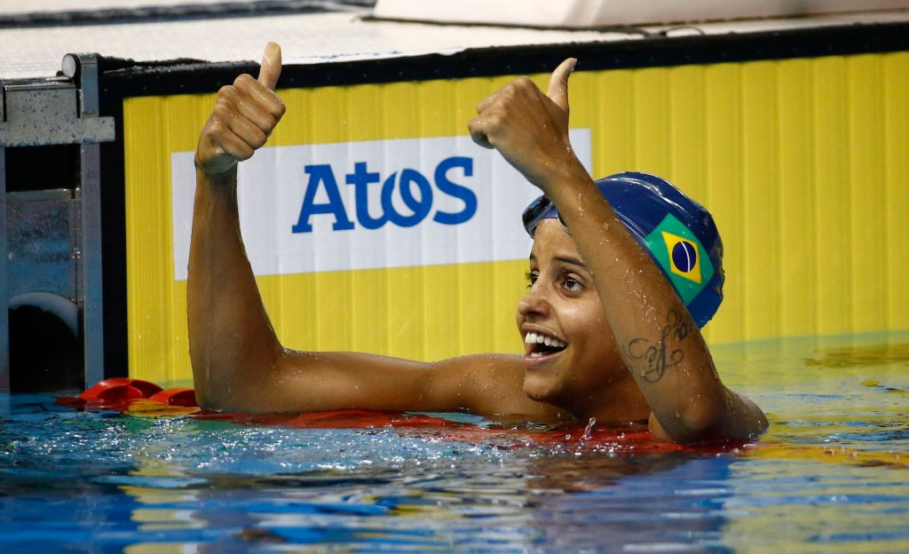 Jul 17, 2015; Toronto, Ontario, CAN; Etiene Medeiros of Brazil celebrates after winning the women's 100m backstroke final the 2015 Pan Am Games at Pan Am Aquatics UTS Centre and Field House. Mandatory Credit: Rob Schumacher-USA TODAY Sports