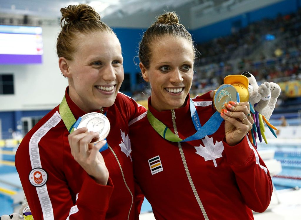 Jul 15, 2015; Toronto, Ontario, CAN; Dominique Bouchard and Hilary Caldwell of Canada celebrates winning the gold and silver in the women's 200m backstroke final during the 2015 Pan Am Games at Pan Am Aquatics UTS Centre and Field House. Mandatory Credit: Rob Schumacher-USA TODAY Sports