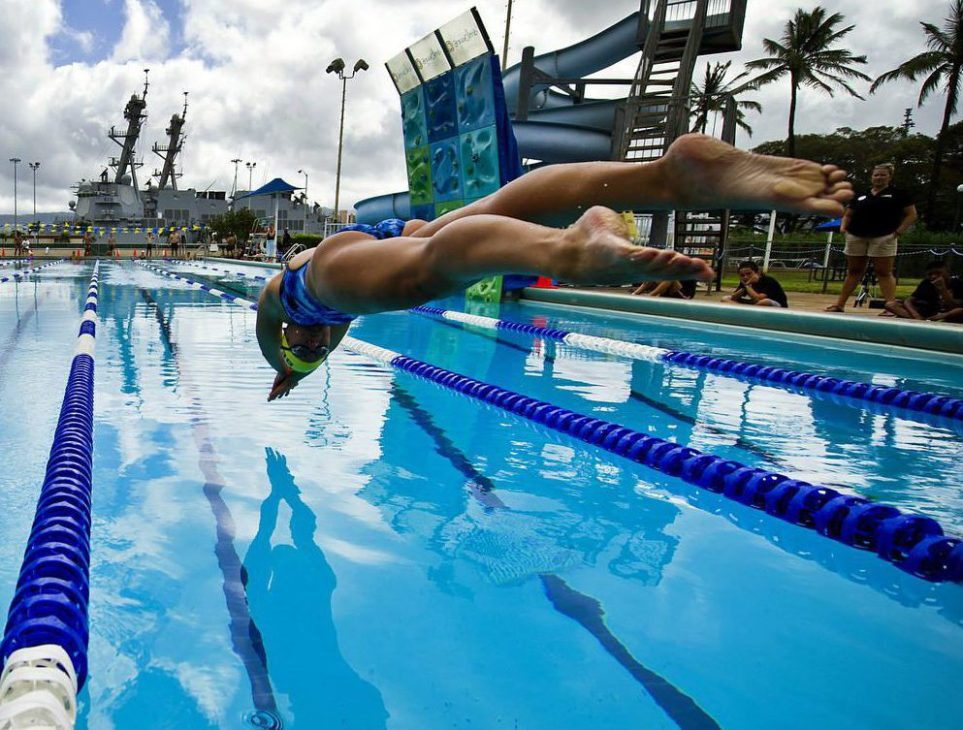 120706-F-MQ656-228 JOINT BASE PEARL HARBOR-HICKAM (July 6, 2012) Sailors from the Royal New Zealand navy and U.S. Navy dive into the pool to start a 200-meter freestyle relay during a Rim of the Pacific Exercise (RIMPAC) international swim meet. Over one hundred Sailors from multiple nations gathered at Scott Pool to compete in a friendly swim meet and get to know each other prior to the start of the operational portion of RIMPAC 2012. Twenty-two nations, more than 40 ships and submarines, more than 200 aircraft and 25,000 personnel are participating in RIMPAC exercise from Jun. 29 to Aug. 3, in and around the Hawaiian Islands. The world's largest international maritime exercise, RIMPAC provides a unique training opportunity that helps participants foster and sustain the cooperative relationships that are critical to ensuring the safety of sea lanes and security on the worlds oceans. RIMPAC 2012 is the 23rd exercise in the series that began in 1971. (Department of Defense photo by U.S. Air Force Tech. Sgt. Michael R. Holzworth/Released)