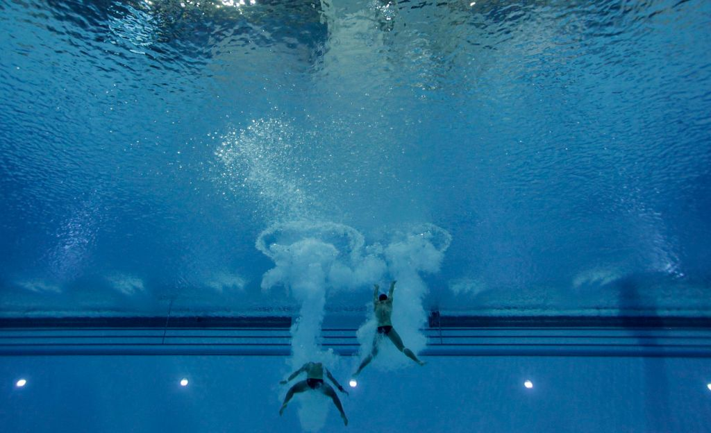 Jul 13, 2015; Toronto, Ontario, USA; Ivan Garcia and Jonathan Ruvalcaba of Mexico compete in the men's synchronized 10m platform final during the 2015 Pan Am Games at Pan Am Aquatics UTS Centre and Field House. Mandatory Credit: Erich Schlegel-USA TODAY Sports