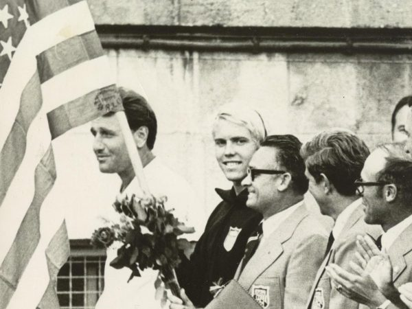 Gary Hall, Sr. no date with flag - E. Germany closing ceremony