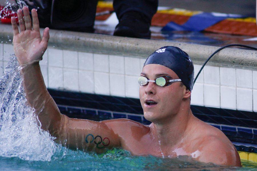 Jun 3, 2017; Santa Clara, CA, USA; Trojan Swim Club swimmer Vladimir Morozov waves to the crowd after winning the A Finals of the Men's 50m Freestyle at George F. Haines International Swim Center. Mandatory Credit: Stan Szeto-USA TODAY Sports