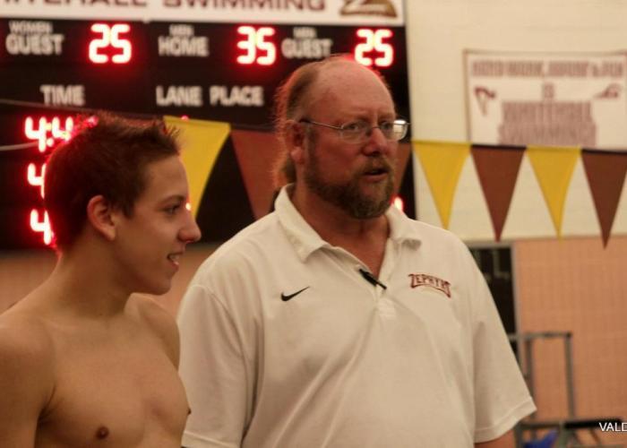 coach coaching swimmer