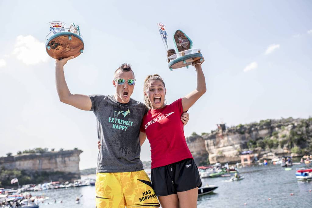 Kris Kolanus (L) of Poland and Adriana Jimenez of Mexico celebrate on the podium during the final competition day of the first stop at the Red Bull Cliff Diving World Series in Possum Kingdom Lake, Texas, USA on June 2, 2018. // Dean Treml/Red Bull Content Pool // AP-1VUWXUWMH2111 // Usage for editorial use only // Please go to www.redbullcontentpool.com for further information. //