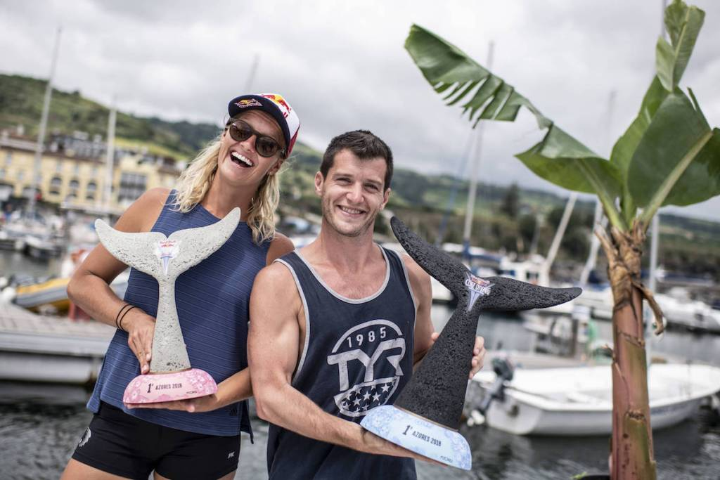 Steven LoBue of the USA and Rhiannan Iffland of Australia pose for a photo with their winners trophies at the marina on Sao Miguel after the final competition day of the third stop at the Red Bull Cliff Diving World Series in Azores, Portugal on July 14, 2018. // Dean Treml/Red Bull Content Pool // AP-1W9B3VUPH2111 // Usage for editorial use only // Please go to www.redbullcontentpool.com for further information. //