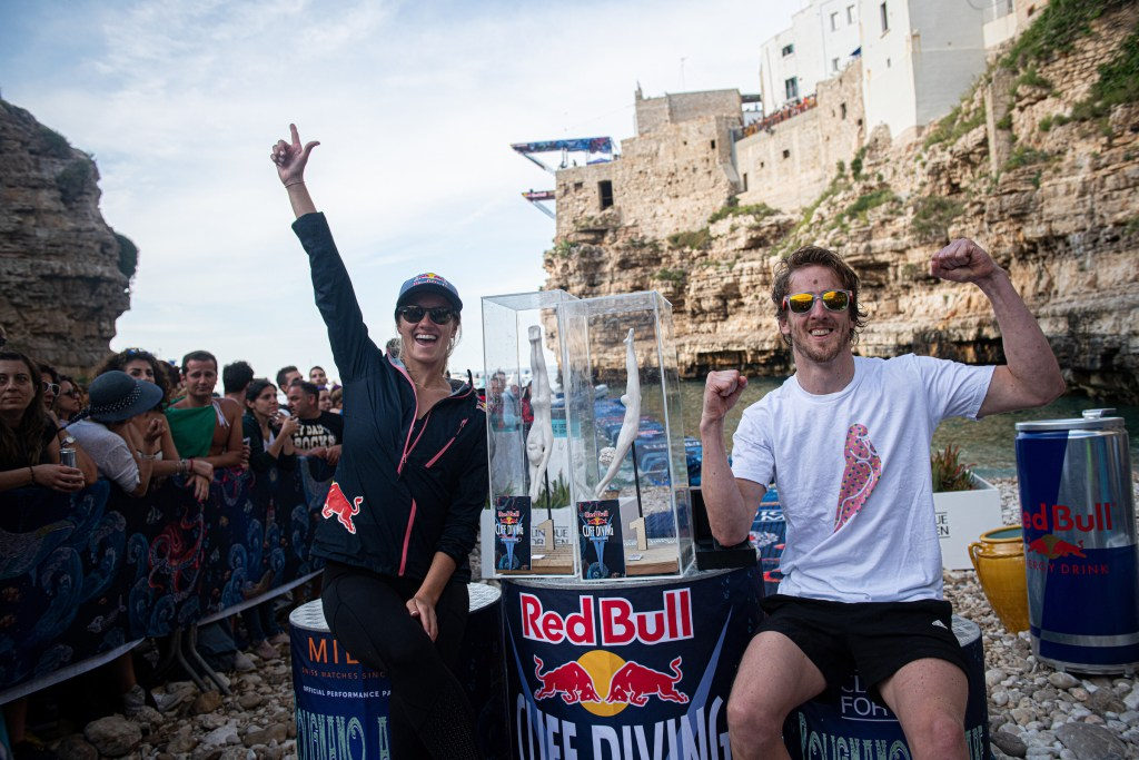 Rhiannan Iffland of Australia and Gary Hunt of the UK celebrate after winning the third stop of the Red Bull Cliff Diving World Series in Polignano a Mare, Italy on June 2, 2019. // Romina Amato/Red Bull Content Pool // AP-1ZHA82MD92111 // Usage for editorial use only // Please go to www.redbullcontentpool.com for further information. //