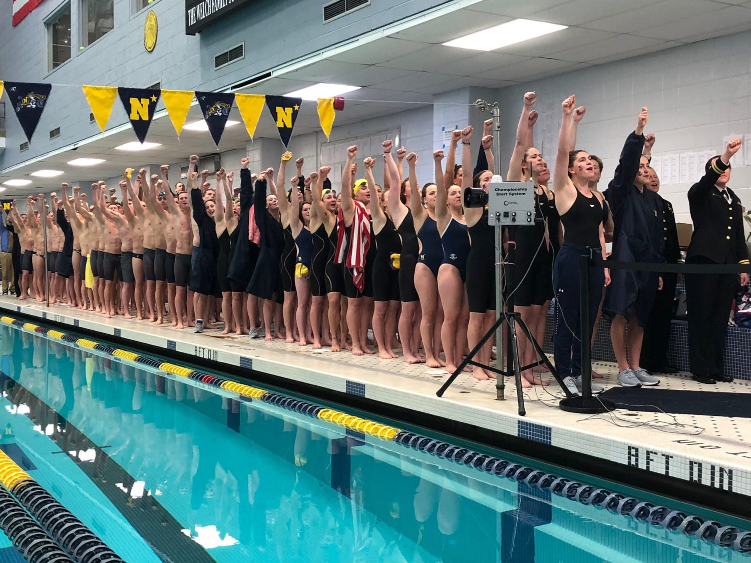Navy Swimming and Diving Defeats Army in Front of Standing Room Only Crowd