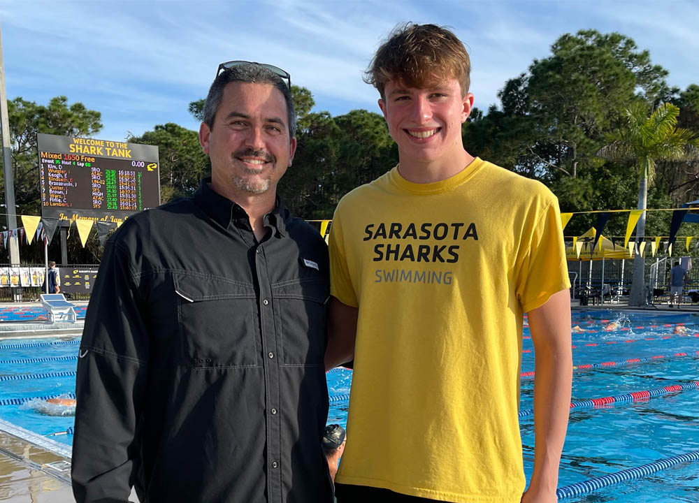 Swimming World March 2021 - Up and Comers - Sarasota YMCA Sharks' Liam Custer - With Coach Brent Arckey