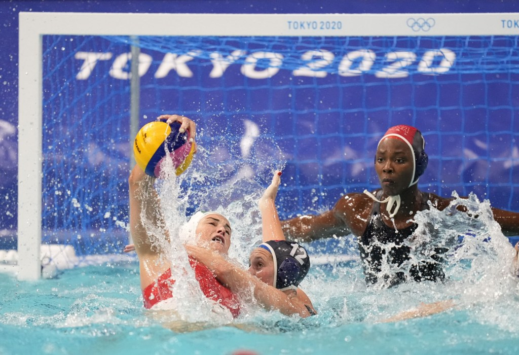 Jul 28, 2021; Tokyo, Japan; Hungary player Rebecca Parkes (6) is defended by USA player Alys Williams (12) in a group B match during the Tokyo 2020 Olympic Summer Games at Tatsumi Water Polo Centre. Mandatory Credit: James Lang-USA TODAY Sports