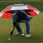 Dana Quigley style, golfing in rain under umbrella