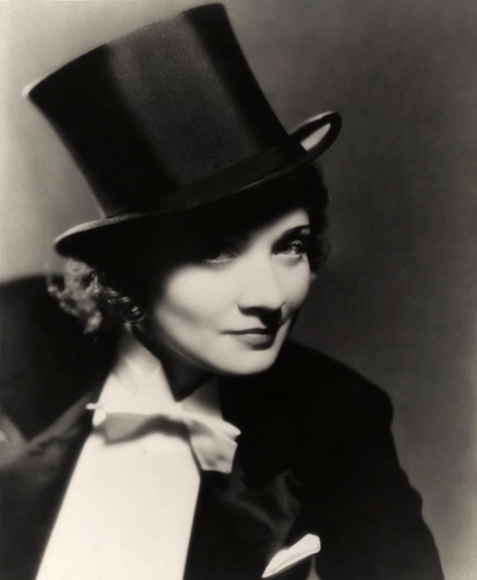 da798366f86 Above and below, we have Marlene Dietrich, who wore this tuxedo in the film  Morocco in 1928. In the scene she sings and even kisses a girl…