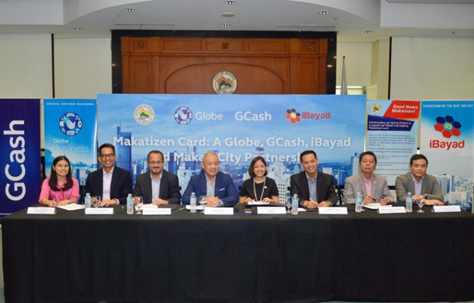 Left to right In the seated photo: Makati City Vice Mayor Monique Lagdameo; SVP for Enterprise Peter Maquera; Chief Commercial Officer Albert de Larrazabal ; Globe President and CEO Ernest Cu; Makati City Mayor Abby Binay; GXI President Abet Tinio; Makati City Administrator Claro Certeza; iBayad CEO Paulo Saycon.