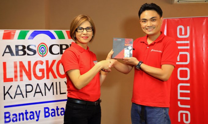 Bantay Bata 163 Program Director Jing Castaneda-Velasco and Starmobile Spokesperson Elijah Mendoza
