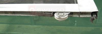 How do you remove the Andersen upper screen door roller  SWISCOcom