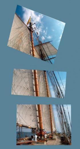 Pride of Baltimore II under full sail, passing the Key Bridge out of Baltimore