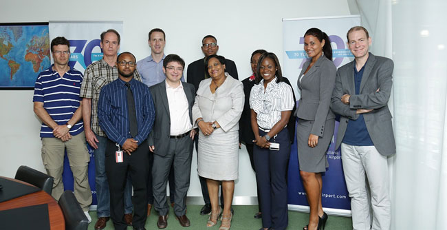 SXM team poses for a photograph with the visiting IMF delegation
