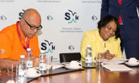 SXM managing director Regina LaBega and TLC managing director, Steve Kong signing the agreement at the Boardroom of SXM Airport Thursday, March 19, 2015