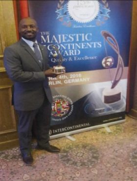 Mr. Anastacio Baker holding the Quality and Excellence Award granted to SXM Airport. (SXM photo)