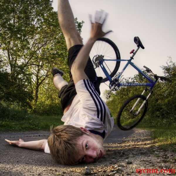 Boy falls off the bike
