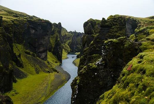 Fjaðrárgljúfur is a canyon in south east Iceland which is up to 100 m deep and about 2 kilometres long, with the Fjaðrá river flowing through it. The canyon has steep walls and winding water.