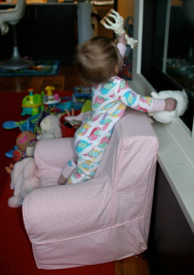Sydney standing on her chair