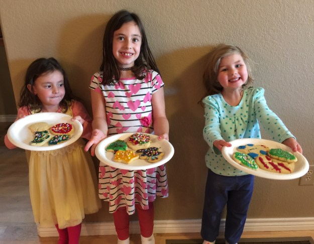 Proud bakers showing off their holiday cookies.