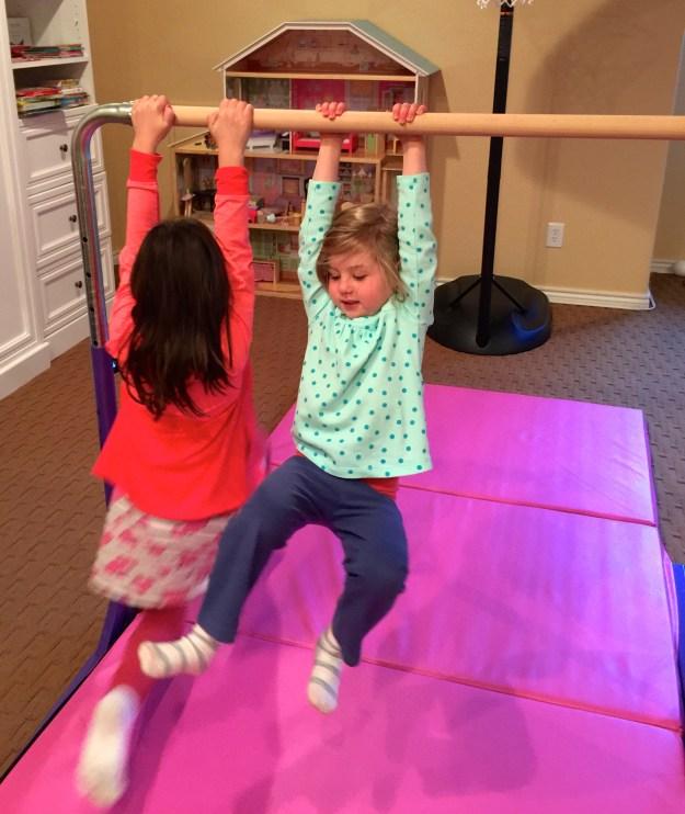 Swinging on the gymnastics bar.