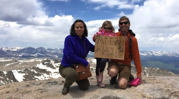 Sydney, Noi, and Dad on the summit of Mt. Evans