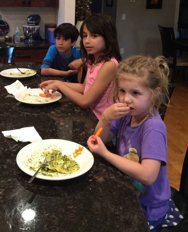 Liam, Lyla, and Sydney enrapt as Chad talks to them during dinner.